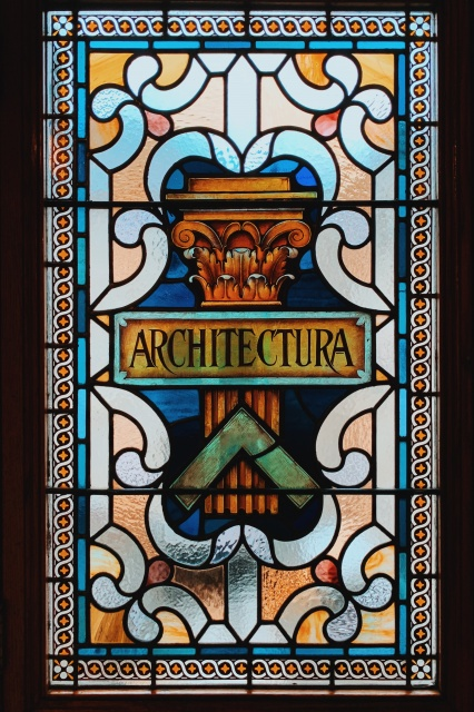 photo of a stained glass window with the word architectura in the center