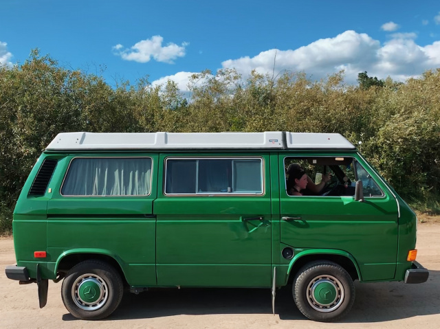 photo of a bright green 80s volkswagon campervan
