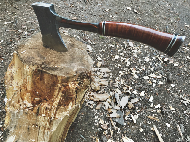 an axe stuck in a stump