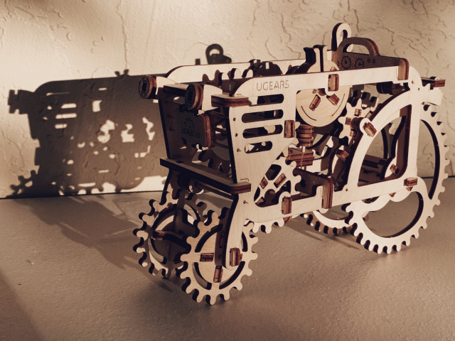 Wood model of a tractor in sunlight