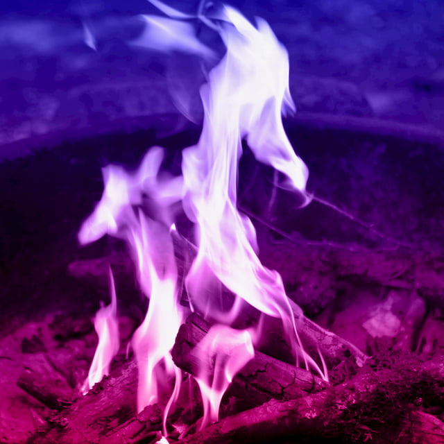 a campfire with colors from purple to red