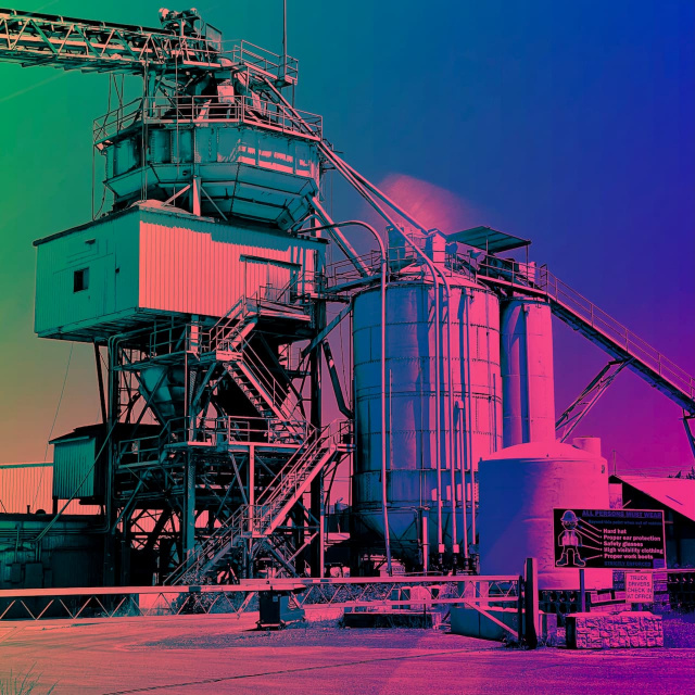 a picture of a factory colorized with gradients