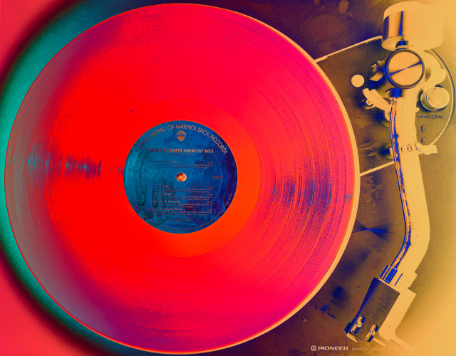 A record on a turntable with digitally altered colors